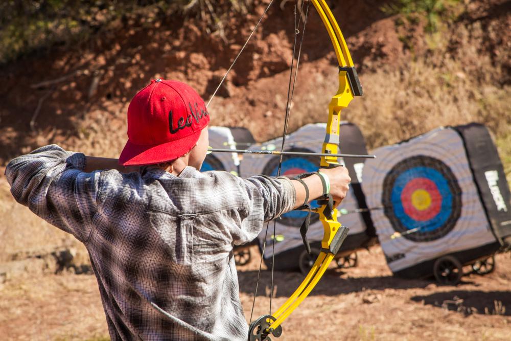 Boy practicing archery