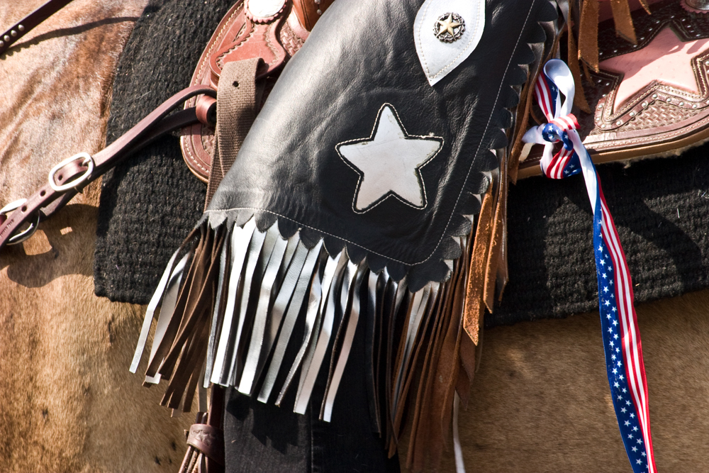 Close up of chaps with fringe and a star cut out