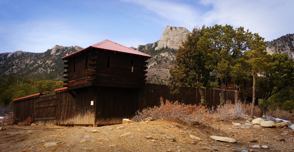 Wooden fort in front of an iconic granite mountain